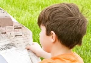 Boys Reading The Newspaper
